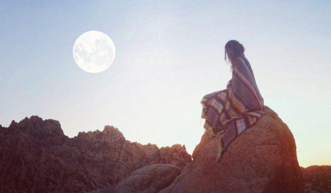 Woman Sitting on Rock, Gazing at Leo Full Moon